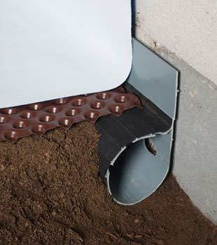 Closeup of a crawl space drainage system installed in Wadmalaw Island